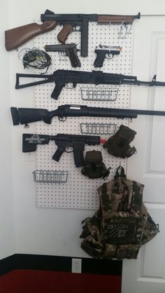 Easy storage for airsoft guns- peg board and pegs from Home Depot. Total Cost $25.00