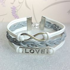 Love Symbol Bracelet,Infinity Bracelet.White Wax Cords and Grey Braid bracelet.. $6.99, via Etsy.