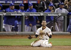 San Francisco Giants' Gregor Blanco smiles after being tagged out at first during the eighth inning of Game 3 of baseball's World Series against the Kansas City Royals on Friday, Oct. 24, 2014, in San Francisco. (AP Photo/Charlie Riedel)