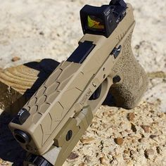 Glock in FDE w/unknown manufacturer slide + Trijicon RMR + unknown light