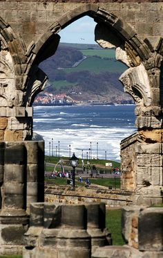 Looking through a door of Whitby Abbey at the West Cliff Beaches, England