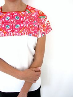 A traditional Mexican blouse cross stitched by the talented hands of the women of the village of El Bosque resulting in a beautiful mosaic of Mexican colors. Stunning embroidery covers the front and the back of the blouse.