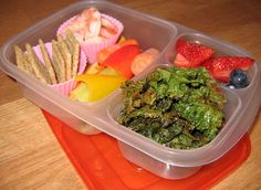 shrimp, Triscuit crackers, fruit and veggies and kale chips
