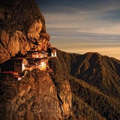 Situated on a rock outcropping some 2,600 feet above the Paro Valley, the Tiger's Nest Monastery is built around a cave where the Indian guru Rinpoche meditated in the 8th century. Guru Rinpoche is said to have arrived on the back of a flying tiger. Today visitors reach the monastery via a climb of several hours that is not for the acrophobic.