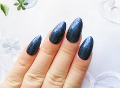 Diy stiletto nails press on nails glue on nails pointy nails these stiletto nails are painted in a deep and shimmery blue the polish used has solutioingenieria Image collections