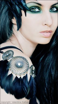 Raven. I wouldn't want to use real feathers, unless they were reused or fell off of a bird naturally, or were a byproduct. I don't want them to be the reason an animal was hurt or killed. Aesthetically, this is beautiful.