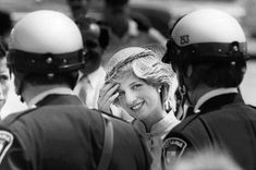June 22, 1983: Princess Diana pushes hair from her face as she thanks her motorcycle police escort prior to departing from Ottawa, Ontario. (Day 9)