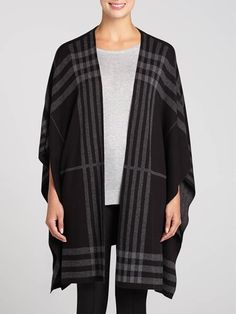 A big trend for Fall is the poncho, so grab this gorgeous poncho-style cardigan to keep your look fresh this season....3030339-0765