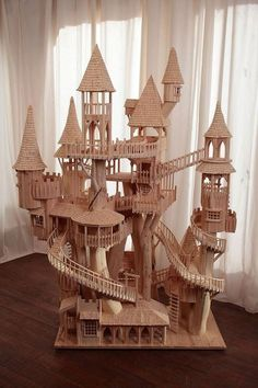 Miniature elf village made with popsicle sticks - by artist is Rob Heard >>> http://www.robheard.co.uk/