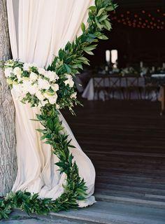 Elegant garland adorned curtains: http://www.stylemepretty.com/2015/11/06/rustic-elegance-at-camp-yonahnoka/ | Photography: Clark Brewer - http://www.clarkbrewerphotography.com/