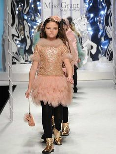 One of my favorite looks in the Fall/Winter 2014/15 collection is this elaborate pink tulle dress with an embellished gold sequin print and pink feather ...