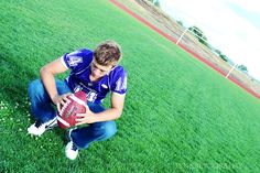 Senior Photo Session-Another great photo idea for a football player. On the field with the field goal in the background.