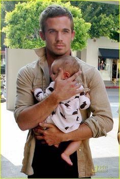 The baby only makes him hotter...