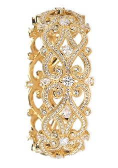 Wearing this stunning gold and crystal bangle to the next big event.