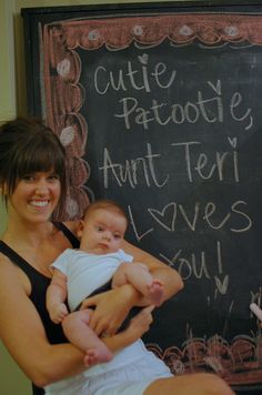 If you have access to a giant chalkboard (or feel like making one) then this is SUCH a great photo booth idea... messages that baby can read when they're older!