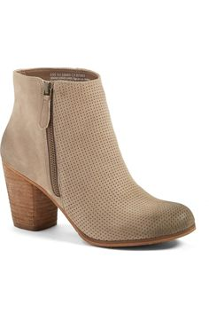 Head over heels for this classic bootie in taupe that is sure to go with everything all season long.