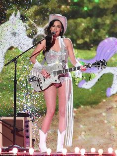 Glittering show: Kacey Musgraves was a crystal cowgirl on Wednesday as she performed at the Country Music Awards in Nashville, Tennessee