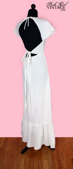 """$229 """"Adorable 70's vintage maxi dress in the cutest backless style. White cotton with crochet on the front. Ties & zips in back. Part of the label is gone but we recognize it as Contempo Casuals. It's one of our favorite stores we shopped at when we were kids. They were all over S. California up until the late 80's. This would make a pretty country or beach wedding dress."""""""