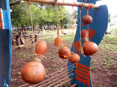 Playtime in Africa design, outdoor sensory play indigenous sound elements made from gourds. By Design Inspire Play for Mmofra Foundation