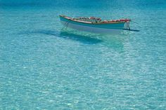 Matira Beach in Bora Bora. Crystal Clear Water, and Coral Reefs... what's not to love?