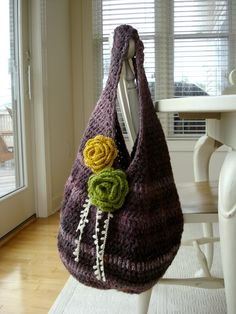 Crochet bag that I want to make for myself! minus the flowers.