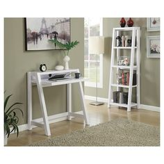 Give your home a studious new look with the Newport Lilly Desk by Convenience Concepts. Perfectly sized to fit any home office or dorm, and featuring a top shelf to hold books, or any other office tools. Available in two different finishes, this piece will easily fit any décor. Coordinating items available, sold separately.