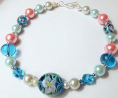 Hey, I found this really awesome Etsy listing at https://www.etsy.com/listing/240561990/girls-flower-blue-pink-green-pearl