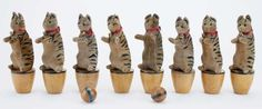 """STEIFF Cat Skittles - 8 piece set: Lot 102 - velvet tiger stripe cats with shoe button eyes mounted on wood bases, each retains silk ribbon with bell around the neck - 4 still have Steiff button in ear, an extremely scarce Steiff skittle toy in well above average condition. 8"""" t."""