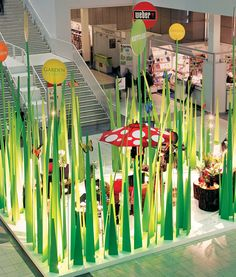 Grass Blades Exhibit literally brings a different world to an everyday space. The display 3d and has interactive elements.