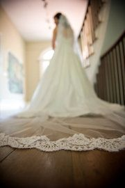 A long veil with lace trim. Classic and elegant.