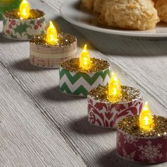 Add a little glitz to battery operated tea lights with tiny scraps of paper and chunky glitter. Battery Operated Tea Lights, Led Tea Lights, Christmas Tea, Christmas Candles, Christmas Lights, Diy Candles, Tea Light Candles, Yankee Candles, Homemade Christmas Gifts
