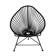 Enjoy hot weather and a tropical cocktail with this woven 1940s-style lounge chair. Inspired by the relaxing feel and airiness of backyard rope hammocks, the chair has been constructed using a traditio...  Find the Cancun Chair with Black Base, as seen in the An Artist's Hacienda Collection at http://dotandbo.com/collections/an-artists-hacienda?utm_source=pinterest&utm_medium=organic&db_sku=92633