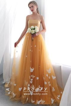 9a690e1ed89 Unique tangerine satin and tulle floor length prom dress with white  butterfly embellishment. Strapless straight