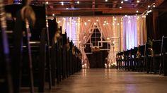 Ceremony backdrop Melrose Market Studios, Seattle, WA. Drapes from Rented Elegance