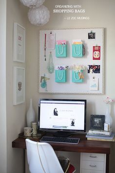 Organizing with shopping bags - pretty bags pinned to a bulletin board with thumbtacks