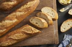 These crunchy baguettes feature a chewy interior riddled with holes, and a crisp, deep-gold crust. Involves a quick sourdough starter. Pain Thermomix, Robot Thermomix, Baking School, Golden Crust, Baking Stone, King Arthur Flour, Dish Towels, So Little Time, Bread Recipes
