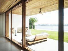 Wood deck with view of water and gorgeous wood ceiling