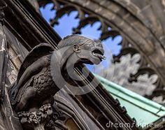 Gothic style, Gargoyle Statue on Saint Vitus Cathedral in Prague Castle Hradcany, Czech Republic.