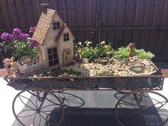 Turn an old Wheelbarrow or Cart into a magical little world…  backyard playground, backyard bbq, backyard games, backyard on a budget  #animals #goat #sheep #dogs #cats #elephant #turtle #pets
