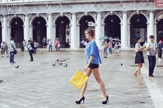 Model Arianna Zaffonato is walking through Piazza San Marco with our new Yellow One.