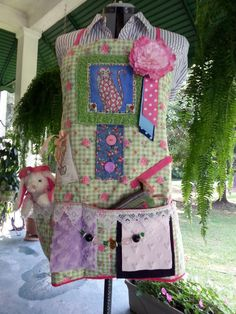 A fidget apron is great for advance stage Alzheimers patients that have a problem keeping up with their personal items.. The apron is quilted I love this idea!!!!!