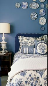 Interesting way to accessorize a #blueandwhite bedroom - with ceramics on the wall!