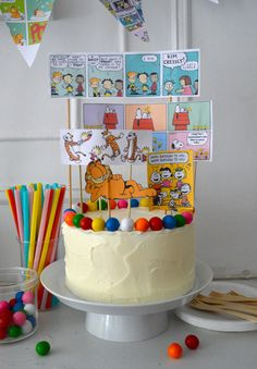 My son requested a comic-themed party for his ninth birthday. He loves  Calvin and Hobbes, Big Nate, and Garfield and came up with his own list of  fun activities based on these characters! For his cake, above, we made  toppers by printing out some comics we found online, trimming and then  taping them to skewers and toothpicks.