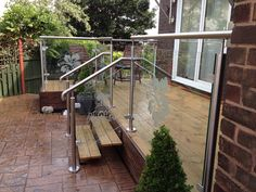 Bespoke glass balustrade panels with floral etched designs
