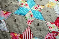 hand quilting; love the grey fabric! A better offset for modern quilts than brighter off whites perhaps. Easier to live with in time?
