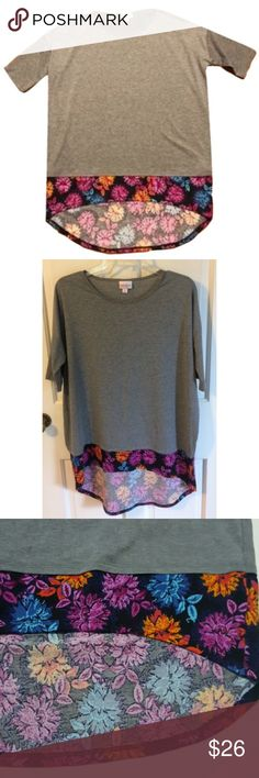"""Lularoe Gray Irma Floral Bottom Oversized Top Lularoe Gray Irma Floral Bottom Top, Size Small but extremely oversized….will it up to a size XL, Gray with a floral hem, Short sleeve, Bust around 28"""", Length 28.5"""", Pre owned great condition! LuLaRoe Tops Blouses"""