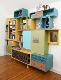 Recycled boxes and cupboards make an interesting wall feature. Very practical for storing items. It would also look great if painted one colour.