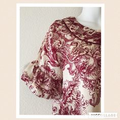 """Host Pick BCBG silk floral top, loose & flowy Lovely and trendy silk top by BCBGMaxAzria. Scoop neck with burgundy piping. Ruffled sleeves and ruffled hem. Cream color with deep burgundy floral design. Perfect condition. Measures 25.5"""" length from shoulder to hem 20"""" across the bust in front from armpit to armpit  Tag says XS but could easily fit a small. BCBGMaxAzria Tops"""