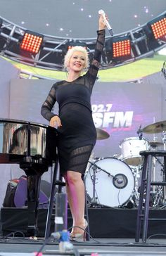 Soon-to-be mama Christina Aguilera rocks her baby bump during a pre-Mother's Day performance at KIIS-FM's Wango Tango 2014 on May 10 in Los Angeles