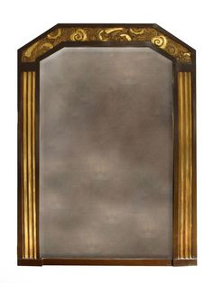 "Art Deco painted and parcel gilt mirror.  The rectangular beveled edge plate with cut corners at the top.  The frame has molded uprights surmounted by a carved and gilt frieze of stylized flowers. CIRCA: 1925 DIMENSIONS: 51"" h x 38"" w"